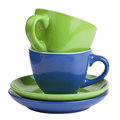 Multicolored teacups and saucers set of green blue cups isolated on white Royalty Free Stock Photo