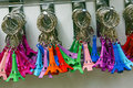 Multicolored tour eiffel key rings souvenir of on sale by a street vendor any copyright for these industrial products Royalty Free Stock Images