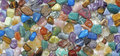 Multicolored tumbled crystal stones background Royalty Free Stock Photo