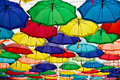 Multicolored umbrella hanging on the sky Stock Image