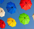 Multicolored umbrellas against the blue sky Royalty Free Stock Photography