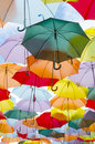 Multicolored umbrellas a lot of over the sky Stock Images