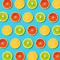 Multicolored vibrant citrus fruit slices texture on turquoise background