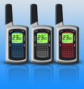 Multicolored walkie-talkies isolated on blue background Royalty Free Stock Photo