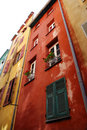 Multicolored walls of old-fashioned houses in Nice Royalty Free Stock Photography