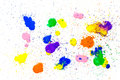 Multicolored watercolor blots isolated on white background. Splashes of a multicolored watercolor paint drops on a white Royalty Free Stock Photo