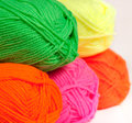 Multicolored wool rolled into balls in the shop closeup Royalty Free Stock Photo