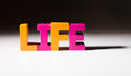 Multicolored word life made of wood text white background Stock Images