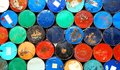Multicolors old rusty oil barrels stack in rows Royalty Free Stock Photo