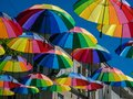 Multicolors umbrellas hunging in the street Royalty Free Stock Photo