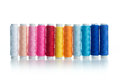 Multicolour bobbins of thread on white background Royalty Free Stock Photography