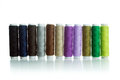 Multicolour bobbins of thread on white background Stock Image