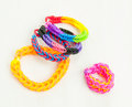 Multicoloured elastic loom band bracelets colourful against a white table top Royalty Free Stock Photography