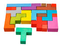 Multicoloured puzzle blocks and t shaped piece isolated on white background Royalty Free Stock Photography