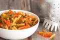 Multicoloured spinach and tomato fusilli pasta white ceramic bowl filled with italian made from dried durum wheat dough formed Stock Photography
