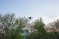 Multicopter is flying in blue sky