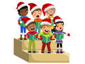 Multicultural kids xmas hat singing Christmas carol choir riser isolated Royalty Free Stock Photo