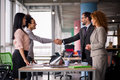 Multiethnic business teams at meeting room shaking hands. Royalty Free Stock Photo