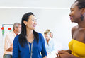 Multiethnic business women talking to each other Royalty Free Stock Photos