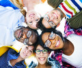 Multiethnic casual people with their heads together group of multi ethnic showing friendship Royalty Free Stock Photos