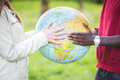 Multiethnic couple multiracial teen holding globe map Stock Photo