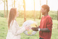 Multiethnic couple multiracial teen holding globe map Royalty Free Stock Photo