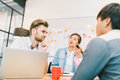 Multiethnic diverse group of people at work. Creative team, casual business coworker, or college students Royalty Free Stock Photo