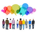 Multiethnic diverse people facing backwards concept with speech bubbles Royalty Free Stock Photography