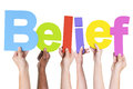 Multiethnic group of hands holding belief Stock Image
