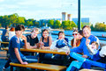 Multiethnic group of young people at lakeside park enjoying the outdoors Stock Images