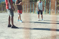 Multiethnic men playing basketball on court Royalty Free Stock Photo