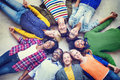 Multiethnic people holding hands and lying down group of Stock Photo