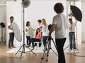 Multiethnic people during photo session group of young in studio Stock Photography