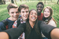 Multiethnic selfie group of teenagers taking a Royalty Free Stock Photos