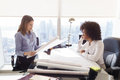 Multiethnic Team Architect Women With Plans And Project Royalty Free Stock Photo