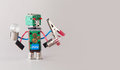 Multifunctional electrician robot with light bulbs and pliers in four hands. Colorful circuit board toy character holds Royalty Free Stock Photo