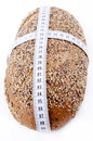 Multigrain bread with measuring tape Stock Photography