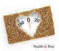 Multigrain slice of bread as weighing scale in shape heart isolated on white Royalty Free Stock Image