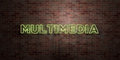 MULTIMEDIA - fluorescent Neon tube Sign on brickwork - Front view - 3D rendered royalty free stock picture