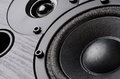 Multimedia speaker system with different speakers closeup over black background Royalty Free Stock Images