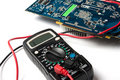 Multimeter and microcircuit Royalty Free Stock Photos