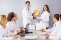 Multinational interns and professor cooperating Royalty Free Stock Photo