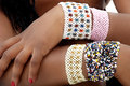 Multiple beaded bracelets on the arms of a black african woman Royalty Free Stock Photography