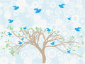 Multiple blue birds perch around tree sky clouds Stock Photography
