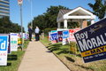 Multiple campaign signs with voters Royalty Free Stock Photo