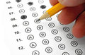 Multiple choice test filling out answers on a with a yellow pencil close up view Royalty Free Stock Photos