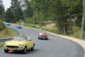 Multiple classic italian sports cars on road fiat spider curvy downhill at event in wintergreen virginia Stock Image