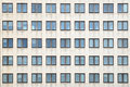Multiple closed windows on a large office building many Royalty Free Stock Photo