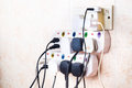 Multiple electricity plugs on adapter risk overloading and dange Royalty Free Stock Photo