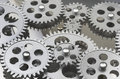Multiple gearing layered shot of silver gears and up close Royalty Free Stock Photography